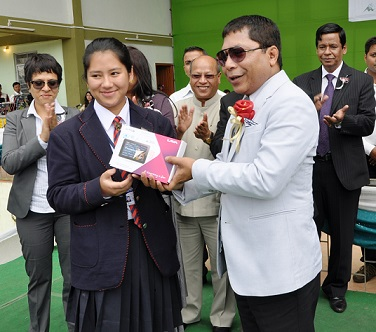 Meghalaya chief minister Mukul Sangma handing over the M-Tab to one of the Class XII students on Wednesday. TM pix
