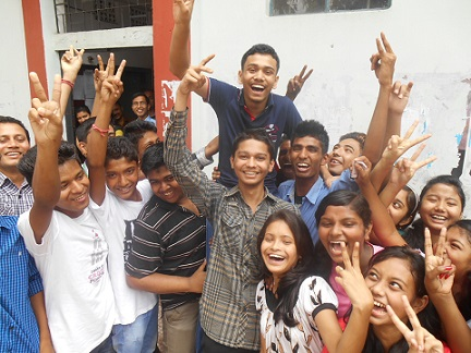 A jubilant Subhendu Karmakar with his school mates after he secured second position in the SSLC examination