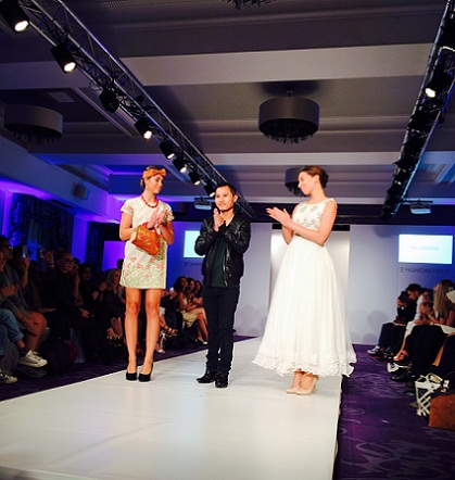 ......Lynrah flanked by the models during the London fashion show