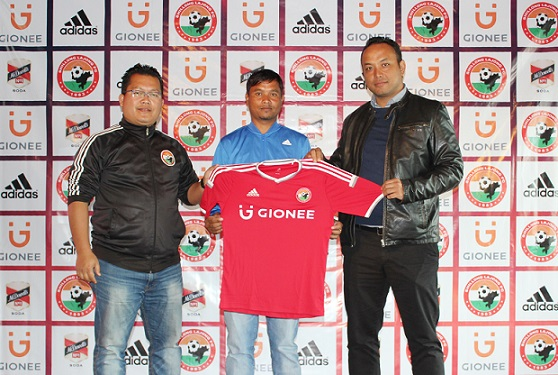 Midfielder Rocus Lamare (middle) will once again don the Shillong Lajong FC colours. Here he is seen with Lajong managing director Larsing Ming (right) and the club's coach